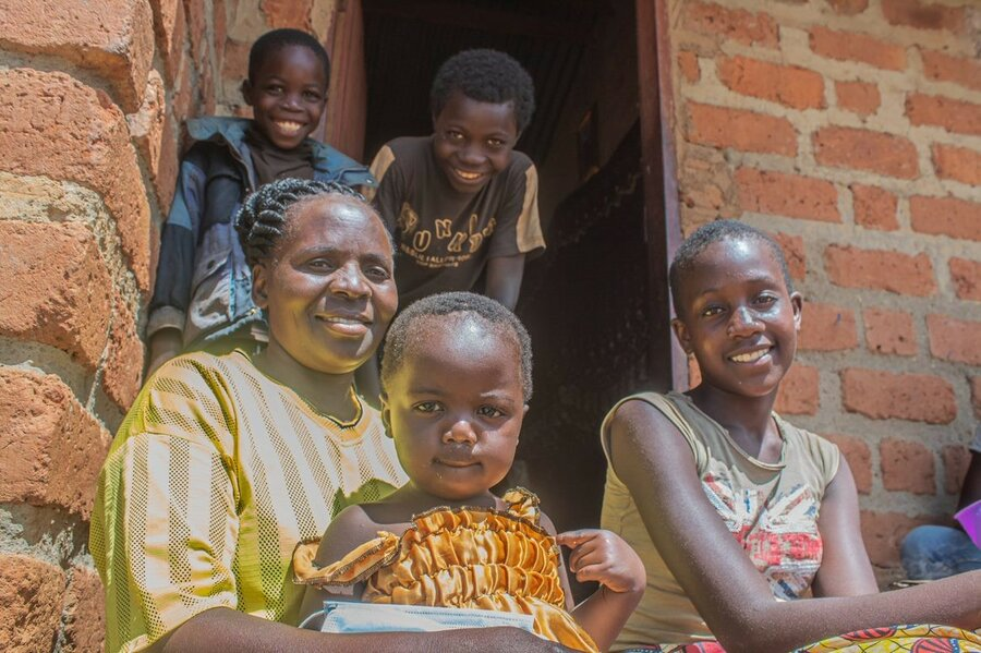 woman sitting and smiling with her children