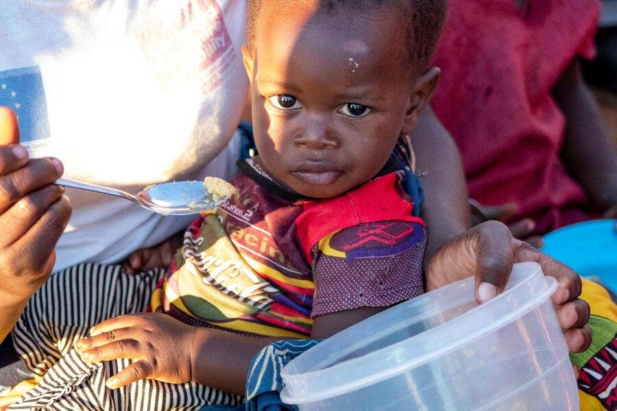 little boy eating porridge