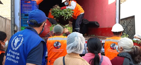 people unloading vegetables from truck