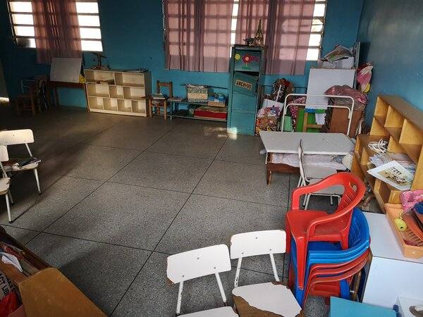 empty classroom with chairs and toys