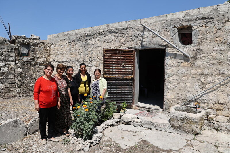 women standing outside house together