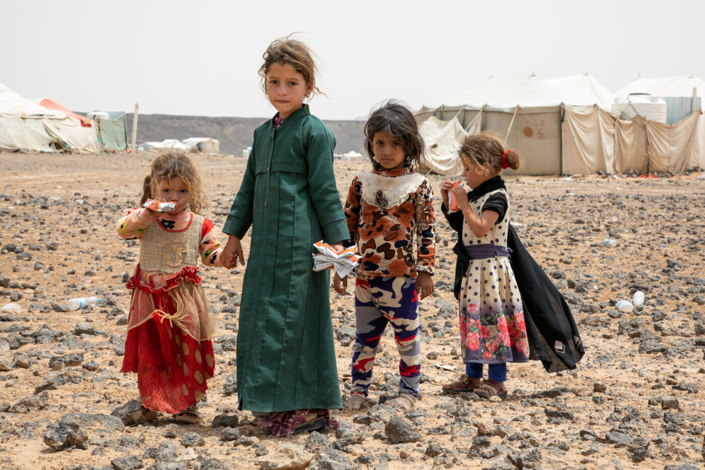 children standing in desert landscape