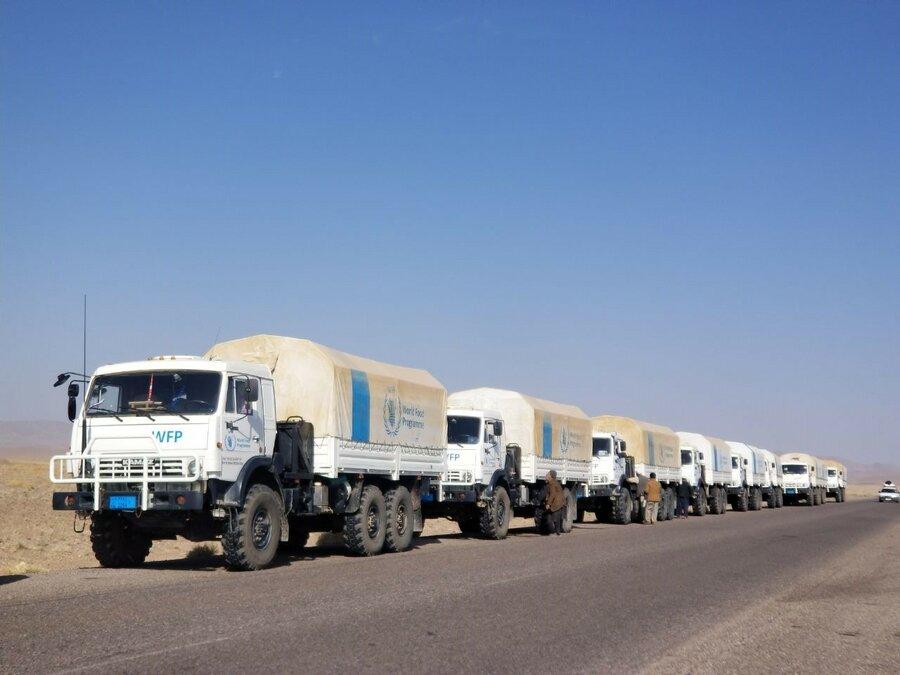 trucks driving down road
