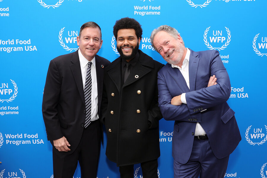 three men standing in front of WFP USA background