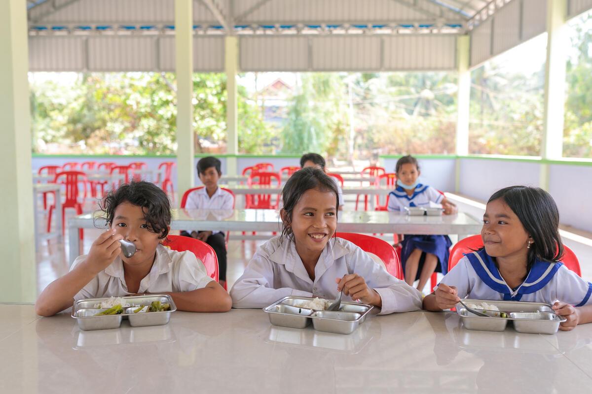 schoolgirls in white uniforms eating lunch