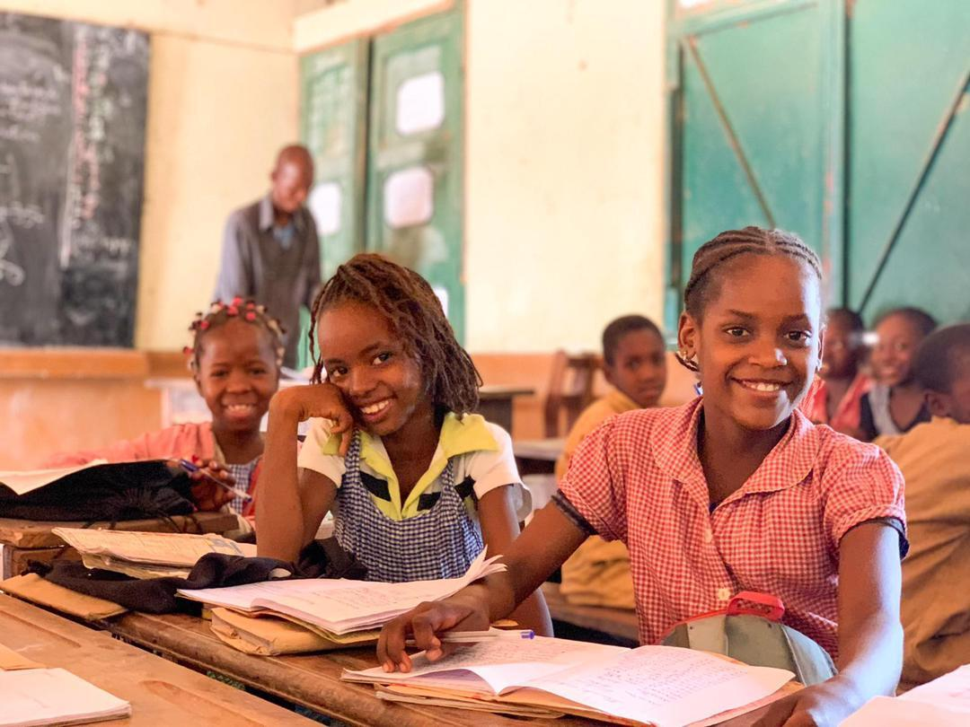 girls smiling in classroom