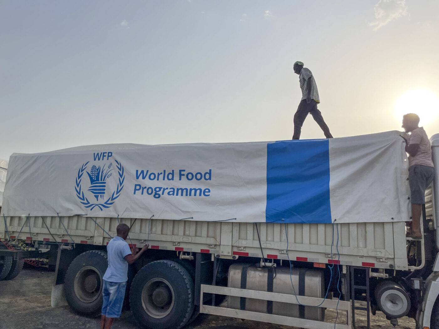 man standing on WFP truck